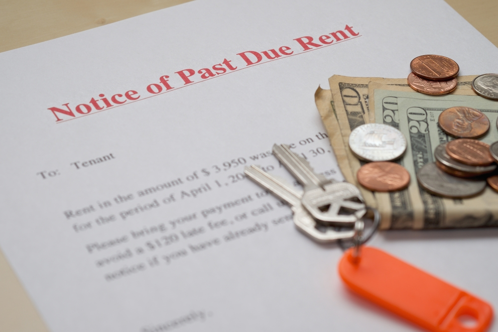 past due rent notice, house keys, coins