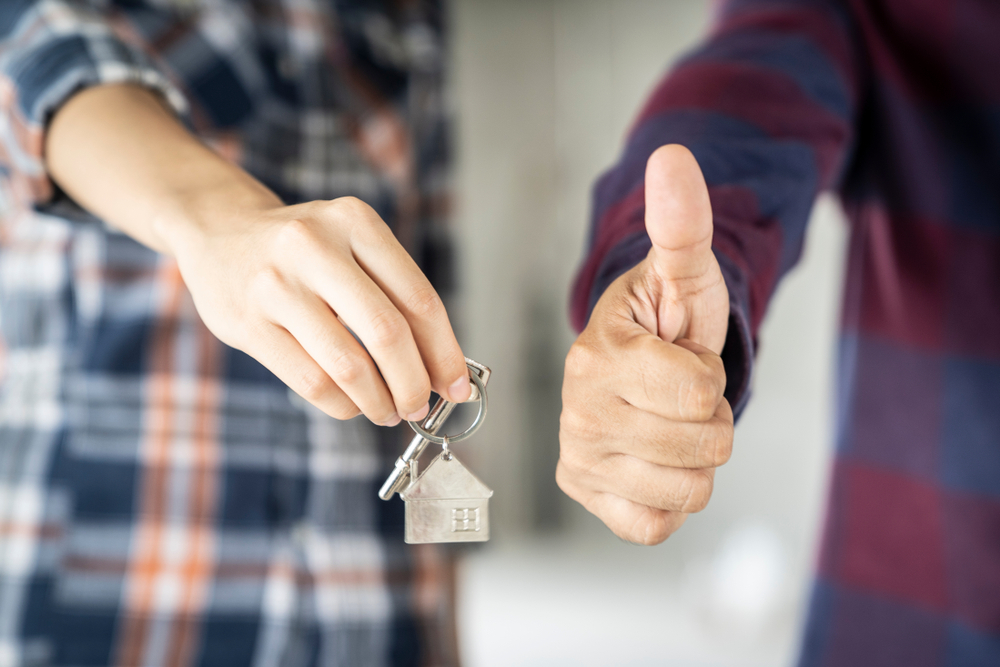 person holding house key ring, person thumbs up, real estate
