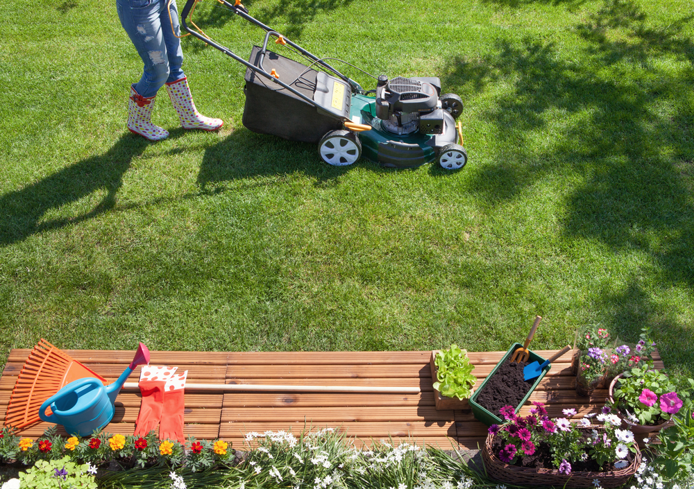 Person mowing lawn, yard care, landscaping
